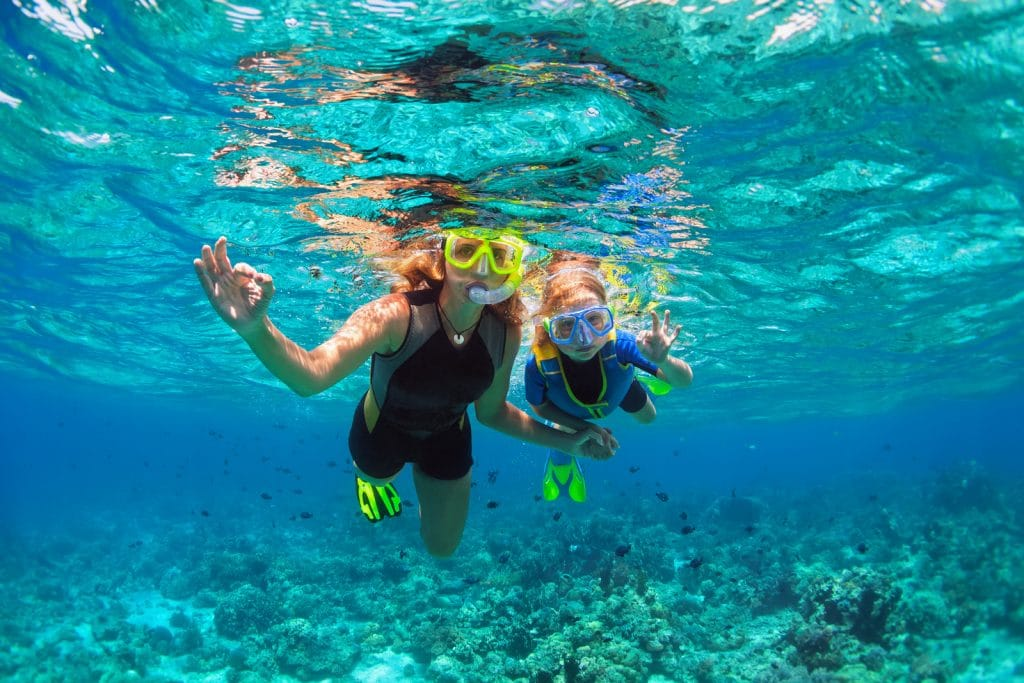 mother, kid in snorkeling mask